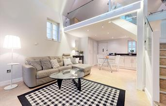 Internal image of self catering accommodation Panfield House. Grey interiors and wooden flooring.