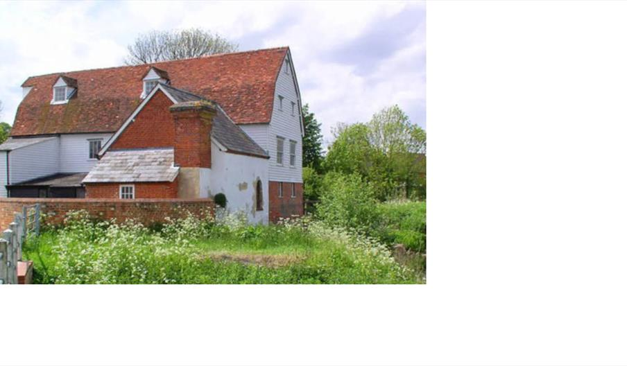 16th century white brick red roof tiled watermill.