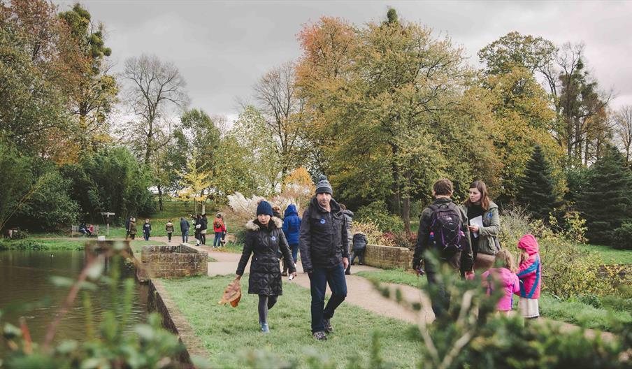 Visitors walking by the lake at Markshall Estate