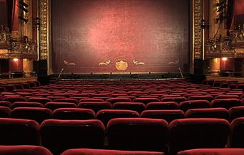 Empty seats in a performance theatre