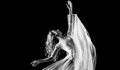Ballet dancer in flowing dress