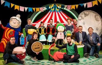 Sarah and Duck, characters in front of the stage.