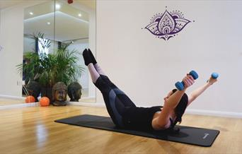 Revitalise - woman on exercise mat