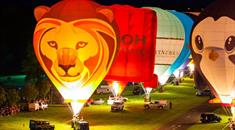 Lion hot air balloon flying over Longleat house during Sky Safari