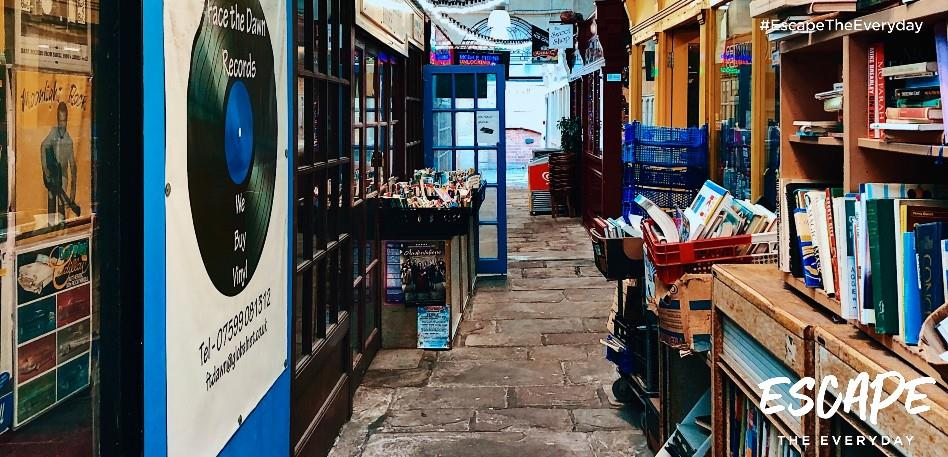 Books and records on shelves outside shops in St Nicholas Market in Bristol