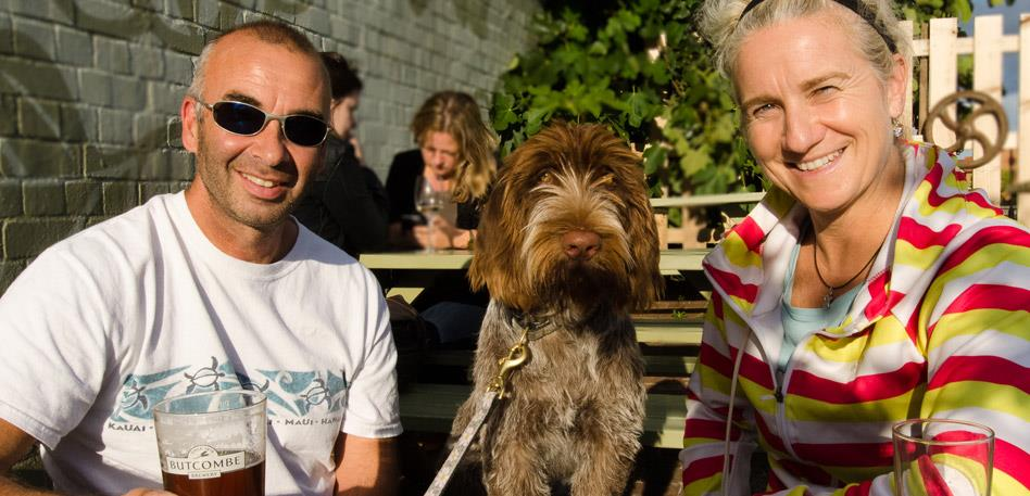 Dog Friendly Bristol - Dog in a pub garden with it's owners: Credit Liz Myers