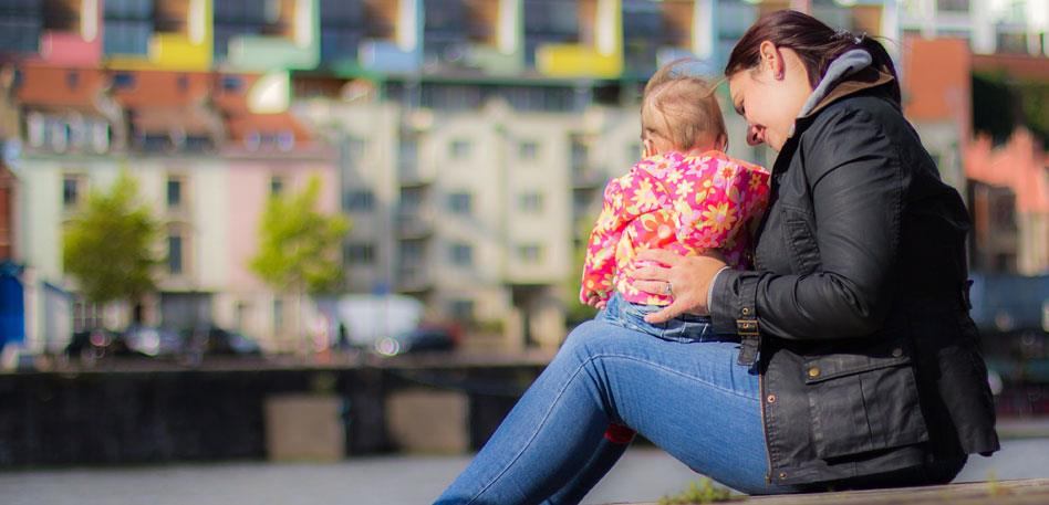 Mum and baby sitting on Bristol Harbourside - Image Daniel Andres