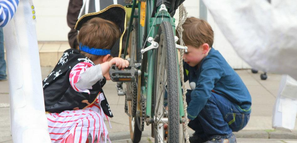 Children fixing a bike at the street fayre