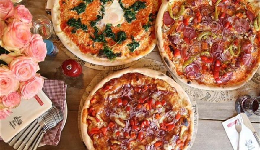 Pizzas at L'Osteria