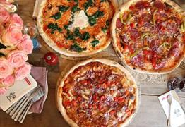 Pizzas at L'Osteria