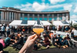 Hand holding beer at Bristol Craft Beer Festival