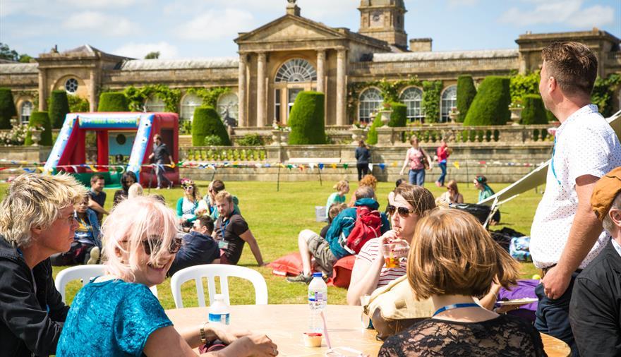 People sat outside enjoying a festival