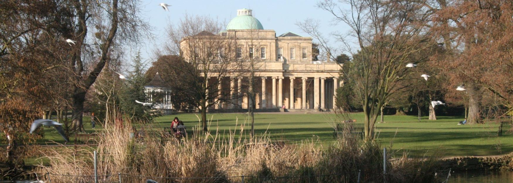 Looking towards Pittville Pump Room through Pittville Park
