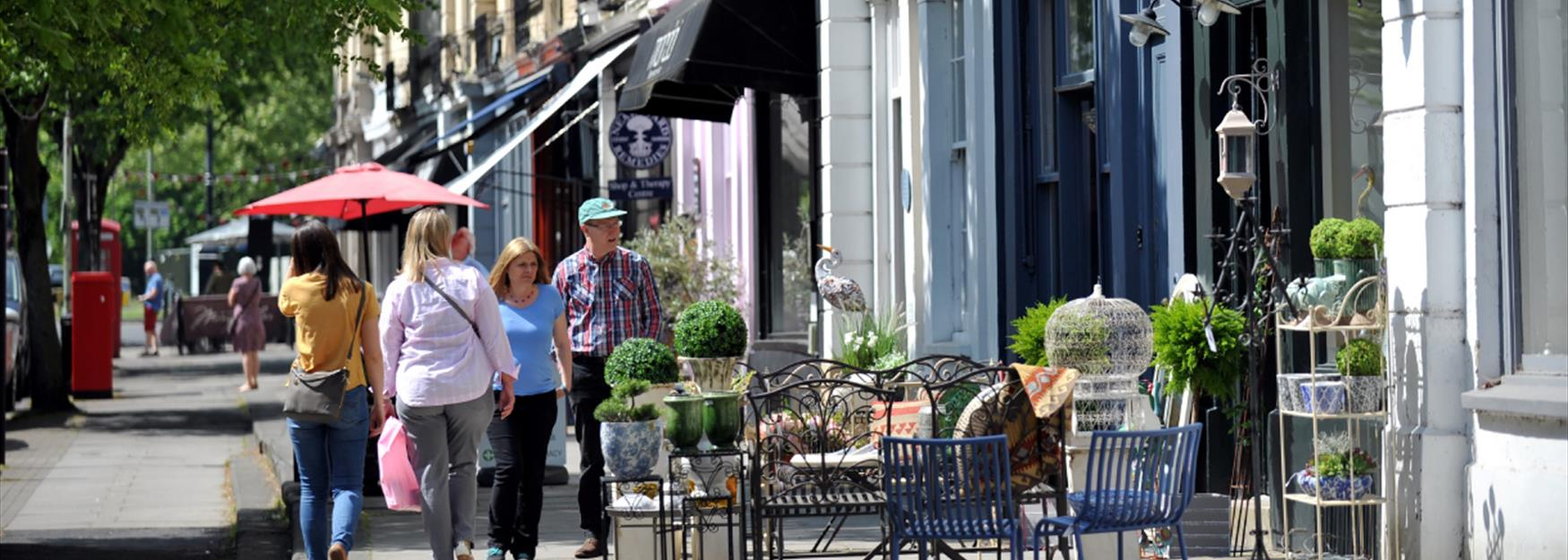 People browsing some of Cheltenham's many independent and boutique shops