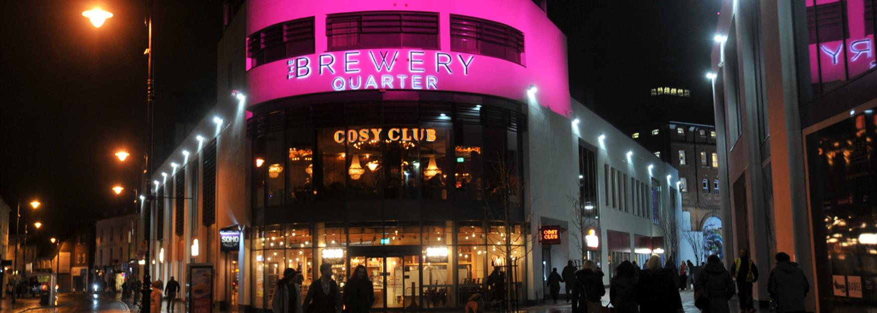 The Brewery Quarter lit up at night