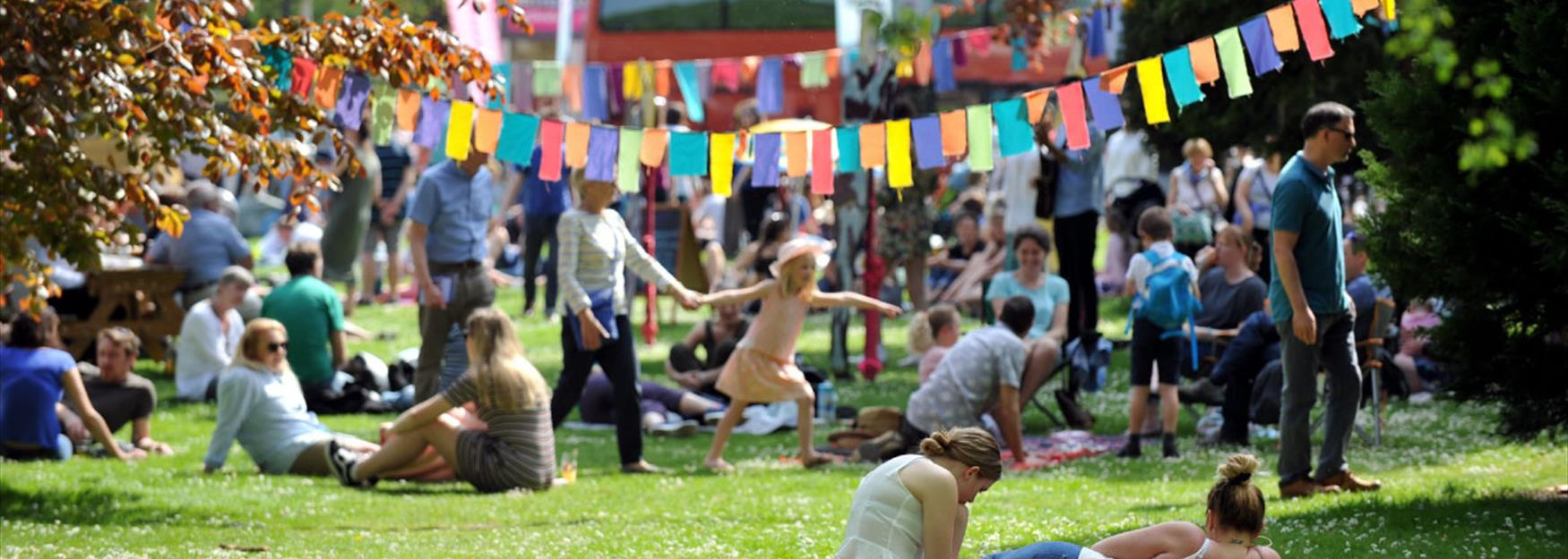People enjoying the atmosphere in a park during a Festival