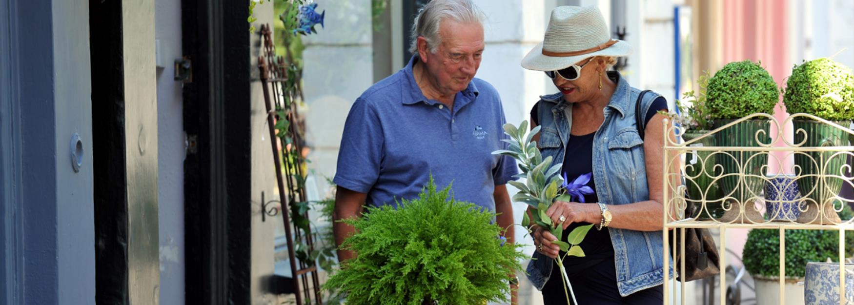 Couple browsing plants and planters outside a shop in Cheltenham