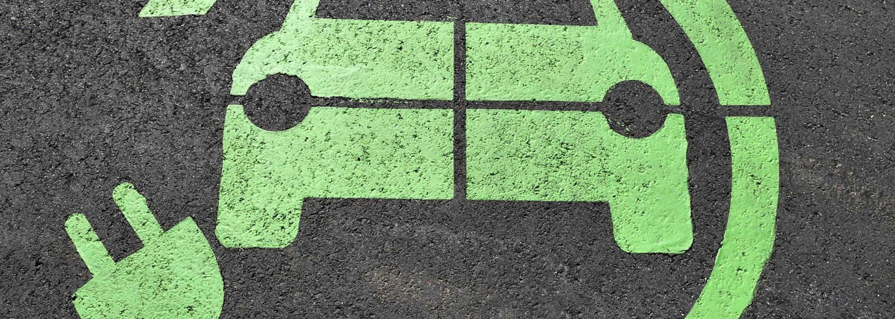 Close up of an electric car charging floor stencil