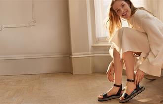 Women wearing a pair of sandals