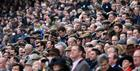 Crowds watching the action at Cheltenham Racecourse
