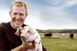 Adam Henson with a piglet at Cotswold Farm Park