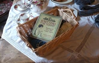 Kitchen table with tea and a basket of knitting