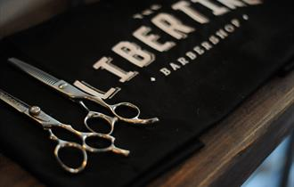 Libertine towel with barber scissors