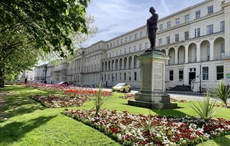 Municipal building and the Long Gardens, Cheltenham. Statue shows Edward Wilson, local hero