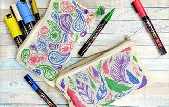 Pencil case full of pens