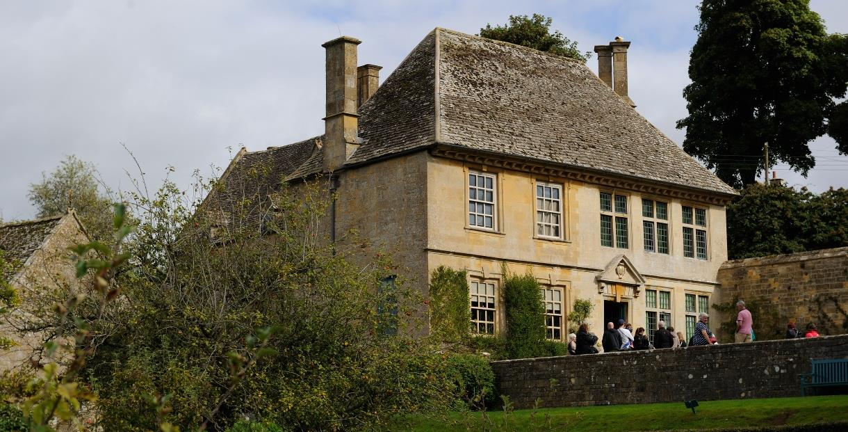 View of Snowshill Manor from the Orchard with visitors