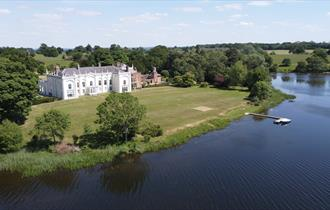 Aerial shot of Combermere Abbey with the mere