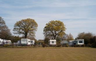 Campsite over bowling green at The Cotton Arms Touring and Camping Site