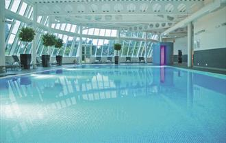 Relax in the spa and pool at the MacDonald Portal Hotel, Golf and Spa