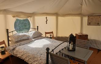 Bed inside a Yurt at Tipsy Tree Glamping