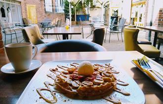 waffle and coffee at Off the Waffle