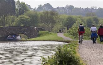 Walkers and cyclists on Chesterfield canal footpath