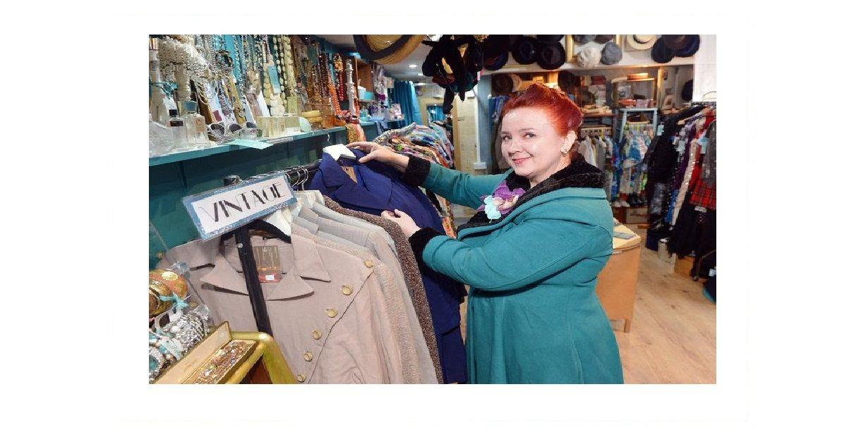 A lady dressed in 1950s clothes shopping in a Vintage clothes shop