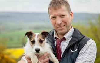 Julian Norton holding a dog