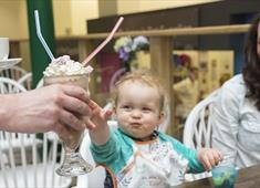 Family enjoying milkshake at The Market Café