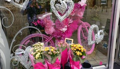 Window display at Thanks A Bunch Flowers and Gifts