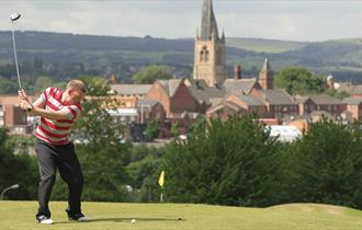 Tapton golf course with Crooked Spire in the distance