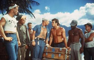 Picture of sailors on shore from South Pacific film