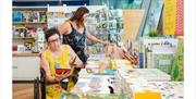 Two women browse Firstsite's shop