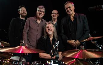 10cc posed with drumkit