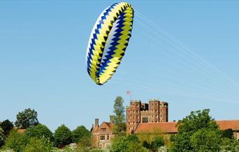 A kite flying in front of Layer Marney Tower