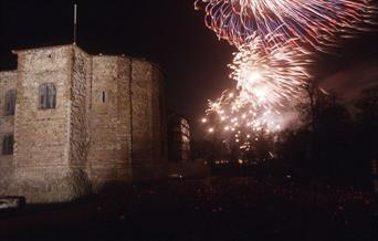 Fireworks in the night sky beside Colchester Castle