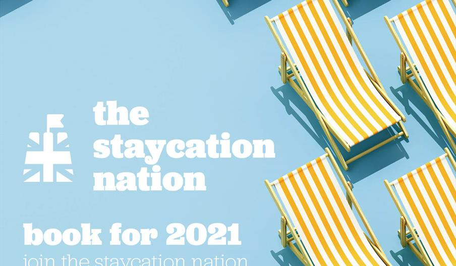 The Staycation Nation advert, blue background with yellow striped deckchairs