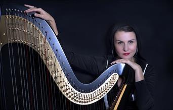 Alina posing with Harp