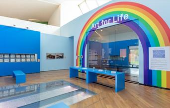 The Art For Life exhibition in Firsite, including it's rainbow wall.