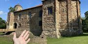 A hand gesturing at Colchester Castle